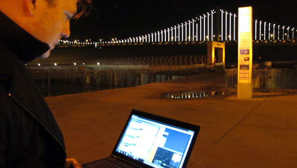 Artist Leo Villareal controls the Bay Lights with his laptop. (Image credit: Cy Musiker/KQED)